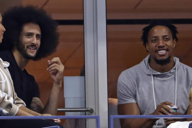 Colin Kaepernick, left and Eric Reid look watch Serena Williams play Venus Williams during the third round of the U.S. Open tennis tournament Friday, Aug. 31, 2018, in New York. (AP Photo/Adam Hunger)