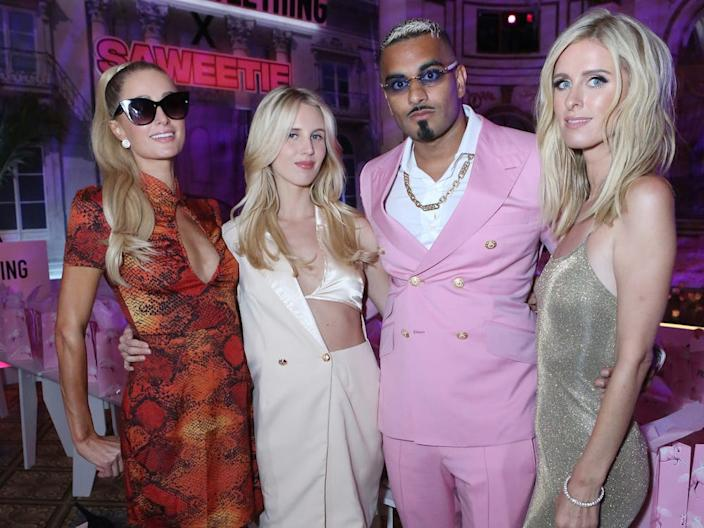 Paris Hilton, Tessa Hilton, Umar Kamani, co-owner of Pretty Little Thing, and Nikki Hilton pose during the Pretty Little Thing x Saweetie Spring/Summer 2020 collection show as part of New York Fashion Week at The Plaza Hotel on September 8, 2019 in New York City.