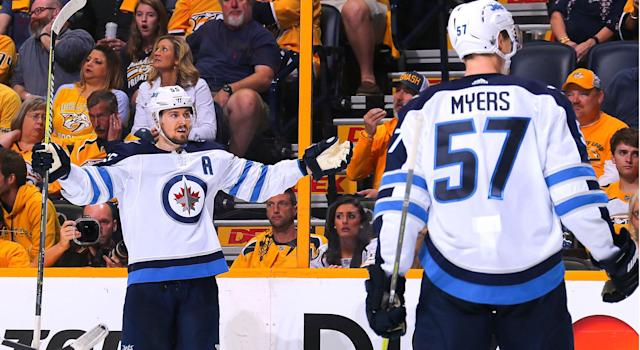 "<a class=""link rapid-noclick-resp"" href=""/nhl/players/5368/"" data-ylk=""slk:Mark Scheifele"">Mark Scheifele</a> celebrates with teammate <a class=""link rapid-noclick-resp"" href=""/nhl/players/4485/"" data-ylk=""slk:Tyler Myers"">Tyler Myers</a> after scoring a goal against the <a class=""link rapid-noclick-resp"" href=""/nhl/teams/nas/"" data-ylk=""slk:Nashville Predators"">Nashville Predators</a> (Photo by Frederick Breedon/Getty Images)"