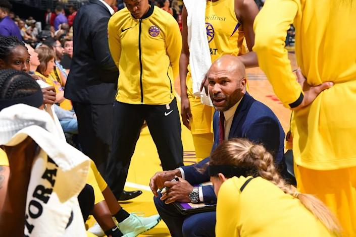 """Sparks coach Derek Fisher speaks to the team during a game against the Las Vegas Aces on Aug. 1, 2019 at Staples Center. <span class=""""copyright"""">(Andrew D. Bernstein / Getty Images)</span>"""