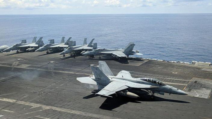 The USS Ronald Reagan as it sails through the South China Sea