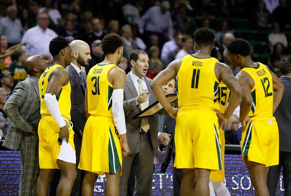 Baylor coach Scott Drew talks with his team during the second half of their 2020 game against Oklahoma State  at Ferrell Center.