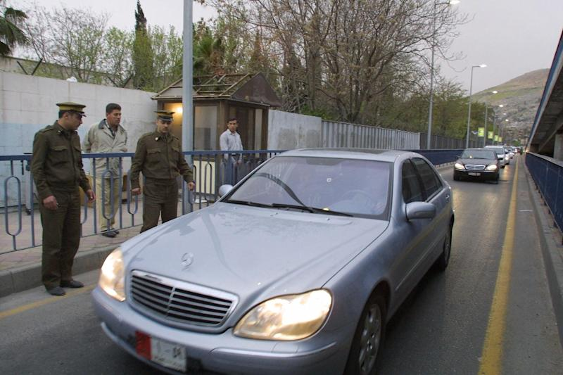 Syrian security forces patrol the Russian embassy compound in Damascus in 2003