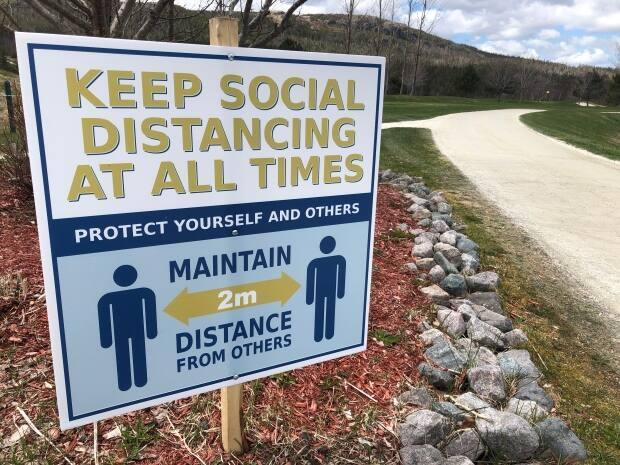 Signs like this one are posted all over The Willows Golf Course in Holyrood. After a successful 2020 season, golf operations manager Pat Guitar says the 2021 season is off to a fast start. (Jeremy Eaton/CBC - image credit)