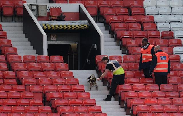 A sniffer dog searches the stands after fans evacuated Old Trafford stadium on May 15, 2016 (AFP Photo/Oli Scarff)