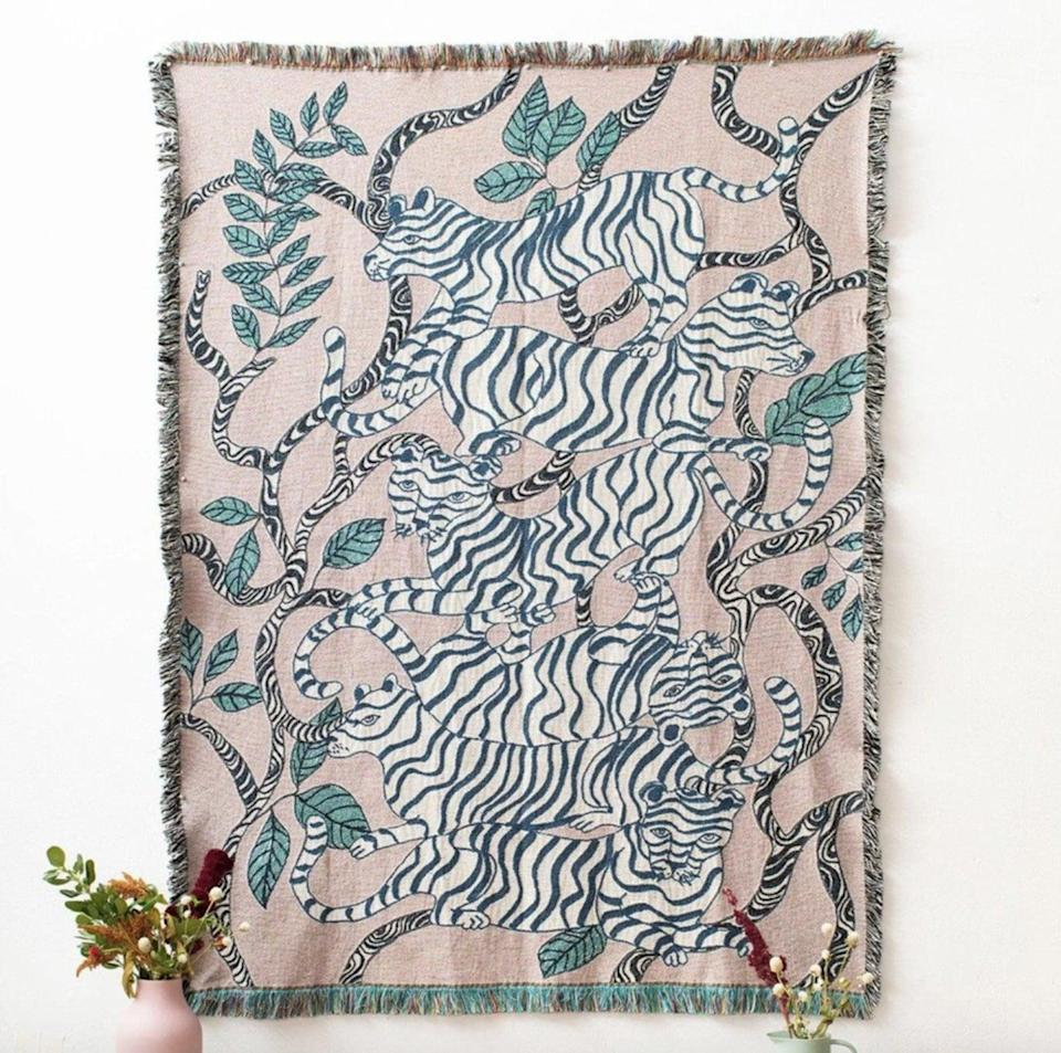 """<p><span>Olivia Wendel Lavender Tigers Blanket</span> ($170) </p> <p>""""These blankets are like a piece of art. I have one as a playful print in my daughters all-neutral nursery."""" - DAC </p>"""