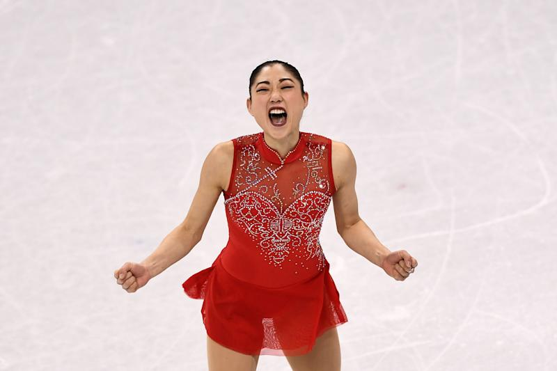 Mirai Nagasugives herself a well-deserved cheer afterher performance in the figure skating team event at the 2018 Winter Olympics. (ARIS MESSINIS/AFP/Getty Images)