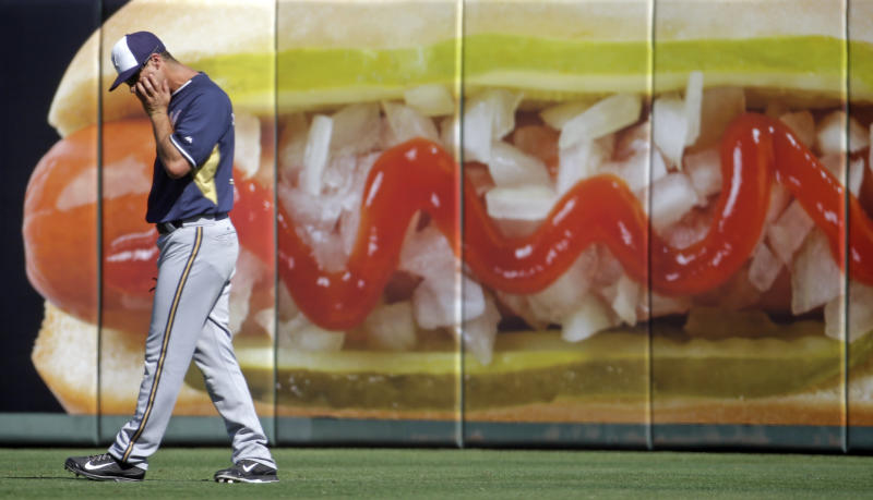 Milwaukee Brewers's Logan Schafer looks down during the fourth inning of an exhibition spring baseball game against the Los Angeles Angels, Wednesday, March 12, 2014, in Tempe, Ariz. (AP Photo/Morry Gash)
