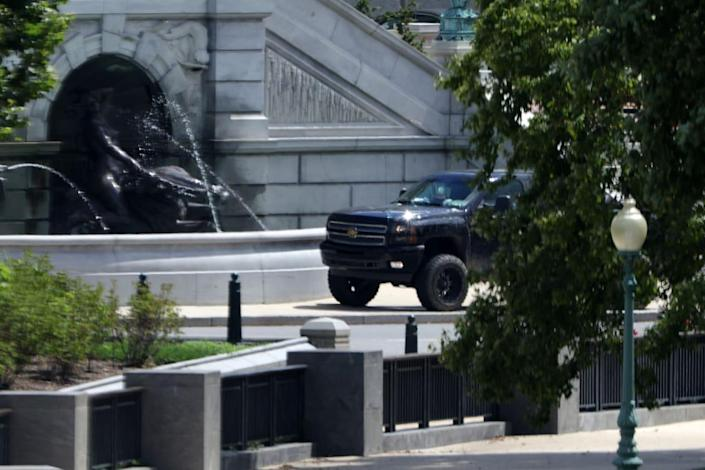 """<div class=""""inline-image__caption""""><p>The black pickup truck parked outside the Library of Congress.</p></div> <div class=""""inline-image__credit"""">Alex Wong/Getty</div>"""