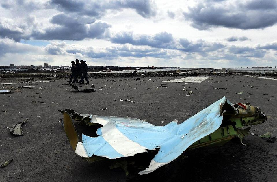 Russian officials examine the wreckage of the flydubai plane which crashed short of the runway at Rostov-on-Don on March 19 (AFP Photo/Vasily Maximov)