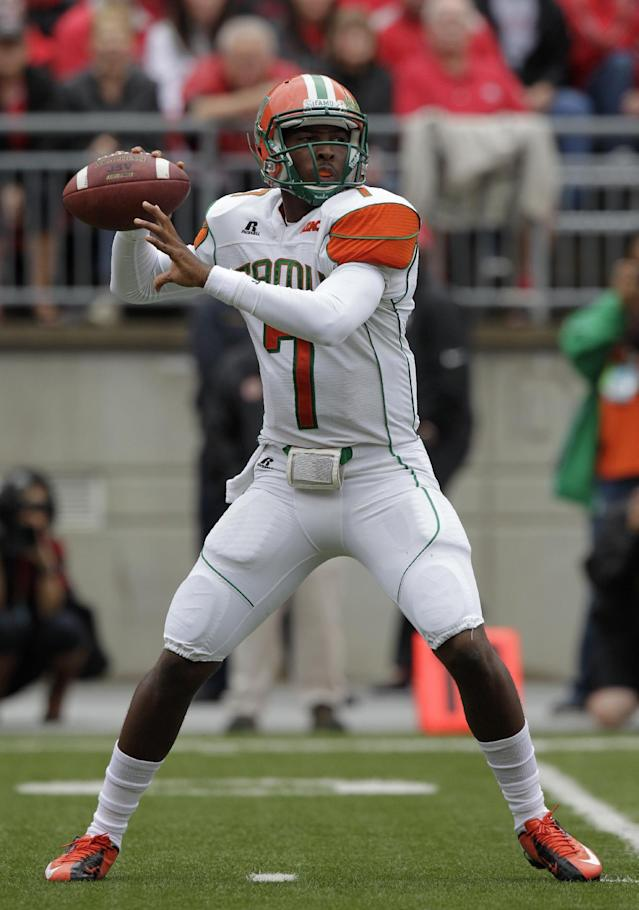 Florida A&M quarterback Damien Fleming drops back to pass against Ohio State during the first quarter of an NCAA college football game Saturday, Sept. 21, 2013, in Columbus, Ohio. (AP Photo/Jay LaPrete)