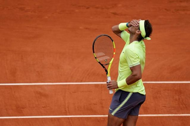 Umpires usually check marks on the clay to decide if a shot was out or in (AFP Photo/Kenzo TRIBOUILLARD)