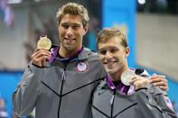 """(L-R) Gold medalist <a href=""""http://sports.yahoo.com/olympics/swimming/matthew-grevers-1133007/"""" data-ylk=""""slk:Matt Grevers"""" class=""""link rapid-noclick-resp"""">Matt Grevers</a> of the United States and silver medalist <a href=""""http://sports.yahoo.com/olympics/swimming/nick-thoman-1124656/"""" data-ylk=""""slk:Nick Thoman"""" class=""""link rapid-noclick-resp"""">Nick Thoman</a> of the United States celebrate with their medals during the medal ceremony for the Men's 100m Backstroke on Day 3 of the London 2012 Olympic Games at the Aquatics Centre on July 30, 2012 in London, England. (Photo by Clive Rose/Getty Images)"""