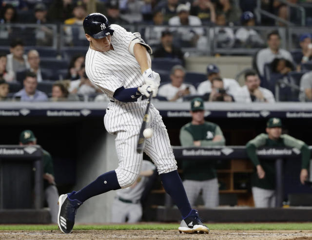 FILE - In this May 11, 2018, file photo, New York Yankees' Aaron Judge hits a three-run home run during the fifth inning of a baseball game against the Oakland Athletics in New York. Baseballs really are getting extra lift, and it's not from the exaggerated upper cuts batters are taking, according to a 10-person committee of researchers hired by the commissioner's office.(AP Photo/Frank Franklin II)