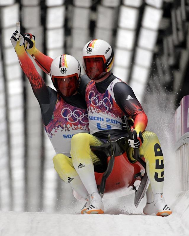 The doubles team of Tobias Wendl and Tobias Arlt from Germany brake in the finish area after their final run to win the gold medal during the men's doubles luge at the 2014 Winter Olympics, Wednesday, Feb. 12, 2014, in Krasnaya Polyana, Russia. (AP Photo/Jae C. Hong)