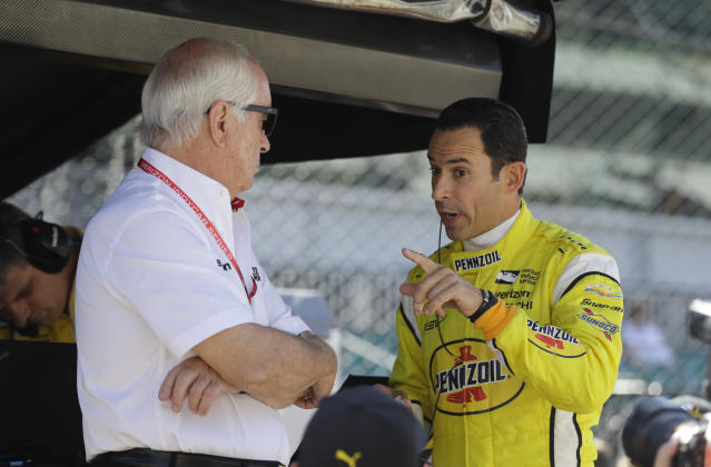 Car owner Roger Penske, left, listens to Helio Castroneves, of Brazil, during the final practice session for the IndyCar Indianapolis 500 auto race at Indianapolis Motor Speedway, in Indianapolis Friday, May 25, 2018. (AP Photo/Darron Cummings)