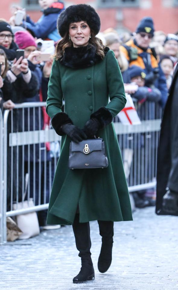 "<p>For her first day in snow-laden Stockholm, the Duchess of Cambridge chose an emerald-hued Catherine Walker coat and accessorised the look with a £895 <a rel=""nofollow"" href=""https://www.mulberry.com/gb/shop/seaton/mini-seaton-black-small-classic-grain"" rel=""nofollow"">Mini Seaton Black Bag from Mulberry</a> and faux fur cuffs by <a rel=""nofollow"" href=""https://www.troylondon.com/collections/accessories/products/faux-fur-cuffs-in-black"">Troy London</a> (£40). <em>[Photo: Getty]</em> </p>"