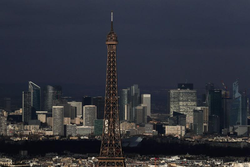 A general view shows the Eiffel Tower and the financial and business district in La Defense, west of Paris