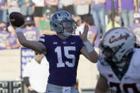 Kansas State quarterback Will Howard (15) passes to a teammate during the first half of an NCAA college football game against Oklahoma State in Manhattan, Kan., Saturday, Nov. 7, 2020. (AP Photo/Orlin Wagner)