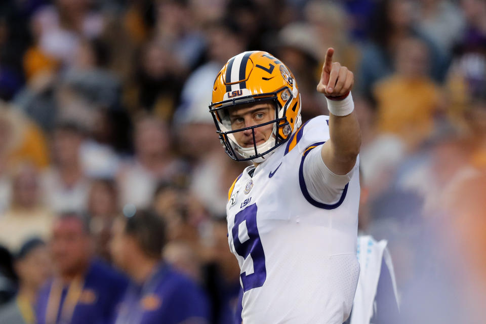 LSU quarterback Joe Burrow (9) warms up before an NCAA college football game against Florida in Baton Rouge, La., Saturday, Oct. 12, 2019. (AP Photo/Bill Feig)