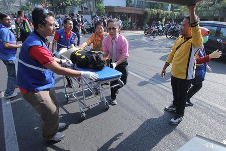 A person injured from a blast at the Indonesian Christian Church is evacuated to a waiting ambulance in Surabaya, East Java, Indonesia May 13, 2018 in this photo taken by Antara Foto. Antara Foto/Didik Suhartono/ via REUTERS