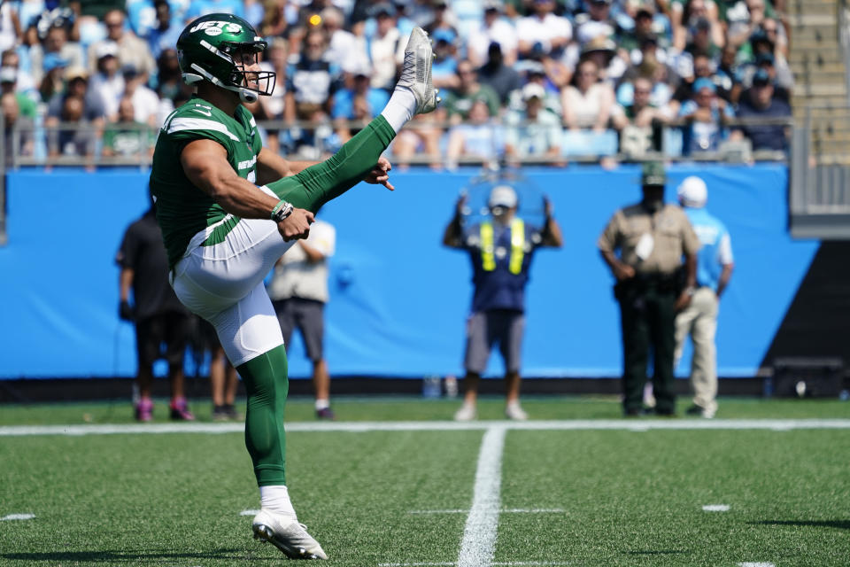 New York Jets kicker Matt Ammendola punts against the Carolina Panthers during the first half of an NFL football game Sunday, Sept. 12, 2021, in Charlotte, N.C. Punter Braden Mann sprained his left knee during his first punt and the Jets had to turn to Ammendola to handle the punting duties. (AP Photo/Jacob Kupferman)