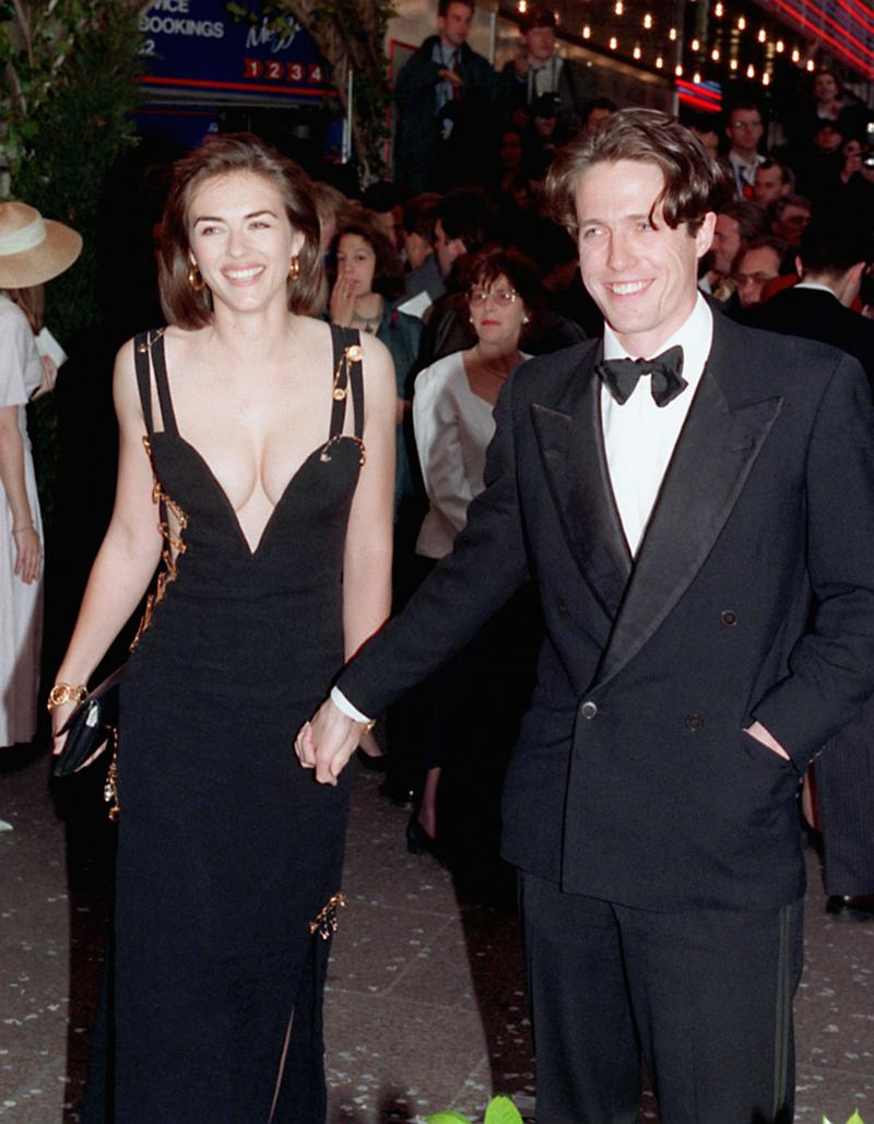 "Elizabeth Hurley and Hugh Grant, pictured at the 1994 film premiere of ""Four Weddings and a Funeral,"" dated for 13 years. (Photo: Michael Stephens - PA Images/PA Images via Getty Images)"