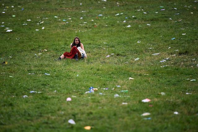 <p>A reveller relaxes by the Stone Circle at Worthy Farm in Somerset during the Glastonbury Festival, in Britain June 22, 2017. (Photo: Dylan Martinez/Reuters) </p>