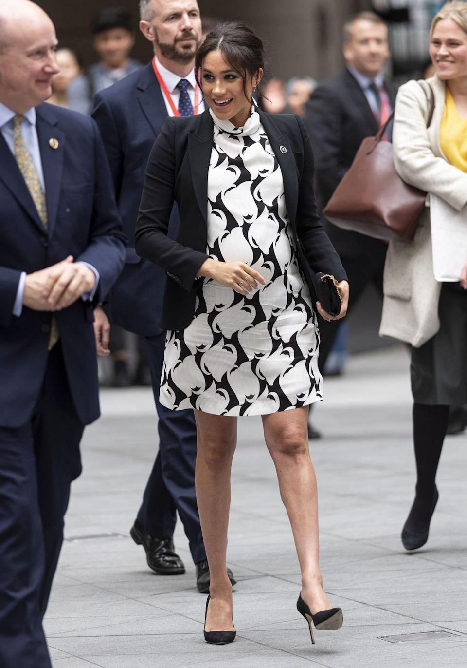 """<p>Meghan Markle arrived at an International Women's Day panel organized by the Queen's Commonwealth Trust, <a href=""""https://www.townandcountrymag.com/society/tradition/a26761685/meghan-markle-vice-president-queens-commonwealth-trust/"""" rel=""""nofollow noopener"""" target=""""_blank"""" data-ylk=""""slk:of which she was just named Vice President"""" class=""""link rapid-noclick-resp"""">of which she was just named Vice President</a>, in a printed black and white dress, black blazer, <a href=""""https://go.redirectingat.com?id=74968X1596630&url=https%3A%2F%2Fshop.nordstrom.com%2Fs%2Fstella-mccartney-shaggy-deer-faux-leather-crossbody-bag%2F4782119&sref=https%3A%2F%2Fwww.townandcountrymag.com%2Fstyle%2Ffashion-trends%2Fg3272%2Fmeghan-markle-preppy-style%2F"""" rel=""""nofollow noopener"""" target=""""_blank"""" data-ylk=""""slk:Stella McCartney clutch"""" class=""""link rapid-noclick-resp"""">Stella McCartney clutch</a> and <a href=""""https://go.redirectingat.com?id=74968X1596630&url=https%3A%2F%2Fshop.nordstrom.com%2Fs%2Fmanolo-blahnik-bb-pointy-toe-pump-women%2F3209276&sref=https%3A%2F%2Fwww.townandcountrymag.com%2Fstyle%2Ffashion-trends%2Fg3272%2Fmeghan-markle-preppy-style%2F"""" rel=""""nofollow noopener"""" target=""""_blank"""" data-ylk=""""slk:Manolo Blahnik heels"""" class=""""link rapid-noclick-resp"""">Manolo Blahnik heels</a>. </p><p><a class=""""link rapid-noclick-resp"""" href=""""https://go.redirectingat.com?id=74968X1596630&url=https%3A%2F%2Fshop.nordstrom.com%2Fs%2Fstella-mccartney-shaggy-deer-faux-leather-crossbody-bag%2F4782119&sref=https%3A%2F%2Fwww.townandcountrymag.com%2Fstyle%2Ffashion-trends%2Fg3272%2Fmeghan-markle-preppy-style%2F"""" rel=""""nofollow noopener"""" target=""""_blank"""" data-ylk=""""slk:SHOP NOW"""">SHOP NOW</a> <em>Stella McCartney Faux Leather Clutch, $875</em></p><p><a class=""""link rapid-noclick-resp"""" href=""""https://go.redirectingat.com?id=74968X1596630&url=https%3A%2F%2Fwww.saksfifthavenue.com%2Fmanolo-blahnik-bb-105-suede-point-toe-pumps%2Fproduct%2F0452430337261&sref=https%3A%2F%2Fwww.townandcountrymag.com%2Fstyle%2Ffashion-trends%2Fg32"""
