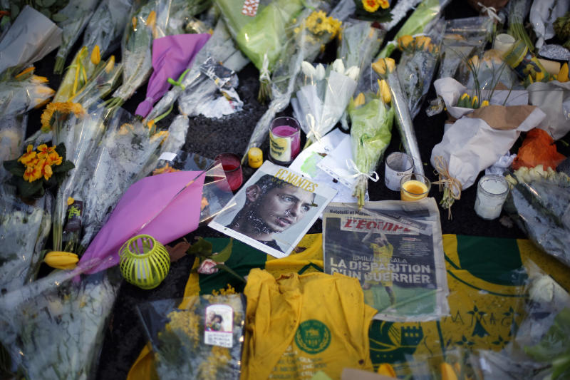 Flowers in homage to player Emiliano Sala are pictured outside La Beaujoire stadium before the French soccer league match Nantes against Saint Etienne, in Nantes, western France, Wednesday, Jan.30, 2019. Argentine soccer player Emiliano Sala disappeared over the English Channel on Jan. 21, 2019 as it flew from France to Wales. Sala had just been signed by Premier League club Cardiff. (AP Photo/Thibault Camus)