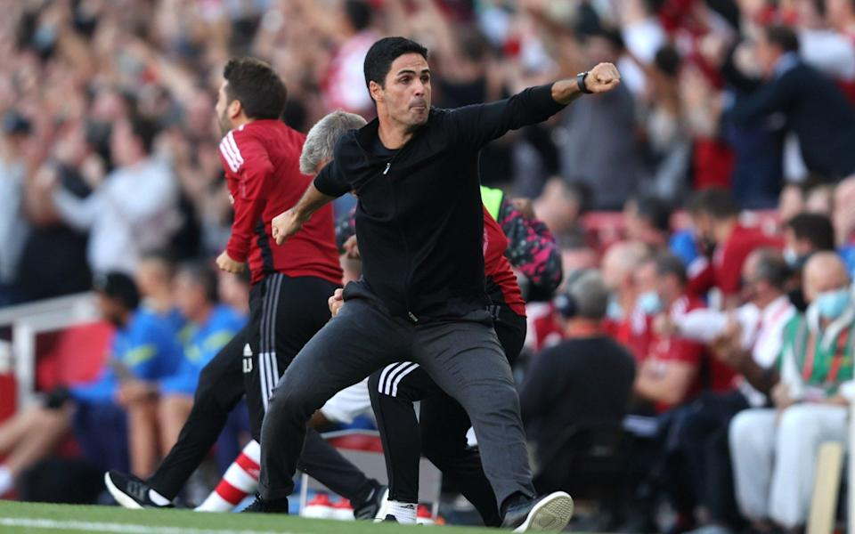 Mikel Arteta, Manager of Arsenal celebrates their side's third goal scored by Bukayo Saka of Arsenal (not pictured) during the Premier League match between Arsenal and Tottenham Hotspur at Emirates Stadium on September 26, 2021 in London, England. - GETTY IMAGES