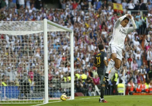 "Real Madrid's Cristiano Ronaldo celebrates after scoring against Barcelona during their Spanish first division ""Clasico"" soccer match at the Santiago Bernabeu stadium in Madrid October 25, 2014. REUTERS/Stringer (SPAIN - Tags: SOCCER SPORT)"