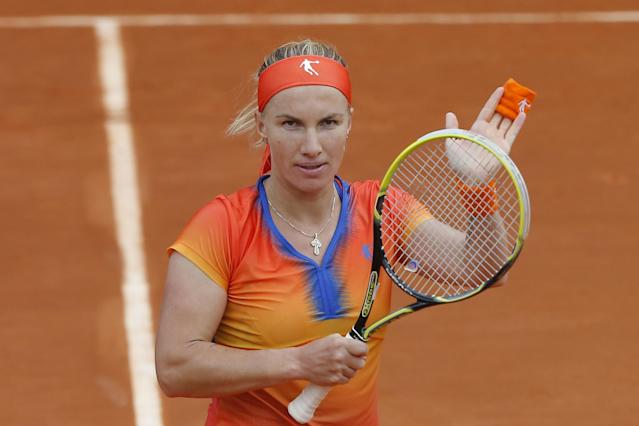 Russia's Svetlana Kuznetsova celebrates winning her second round match of the French Open tennis tournament against Italy's Camilla Giorgi at the Roland Garros stadium, in Paris, France, Thursday, May 29, 2014. (AP Photo/Michel Spingler)