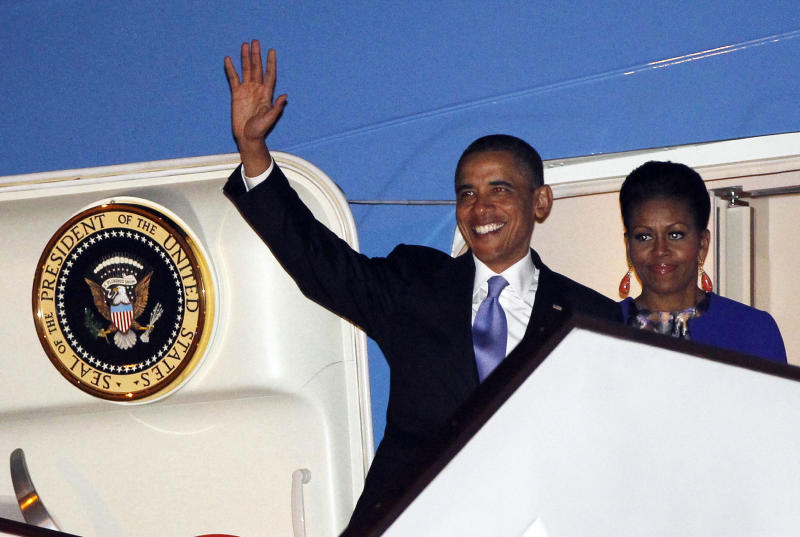 U.S. President Barack Obama and first lady Michelle Obama step off Air Force One as they arrive at London's Stansted Airport, Monday, May 23, 2011. (AP Photo/Charles Dharapak)