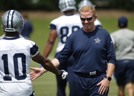 Dallas Cowboys head coach Jason Garrett greets running back Tavon Austin (10) during an organized team activity at its NFL football training facility in Frisco, Texas, Wednesday, May 23, 2018. (AP Photo/Ron Jenkins)