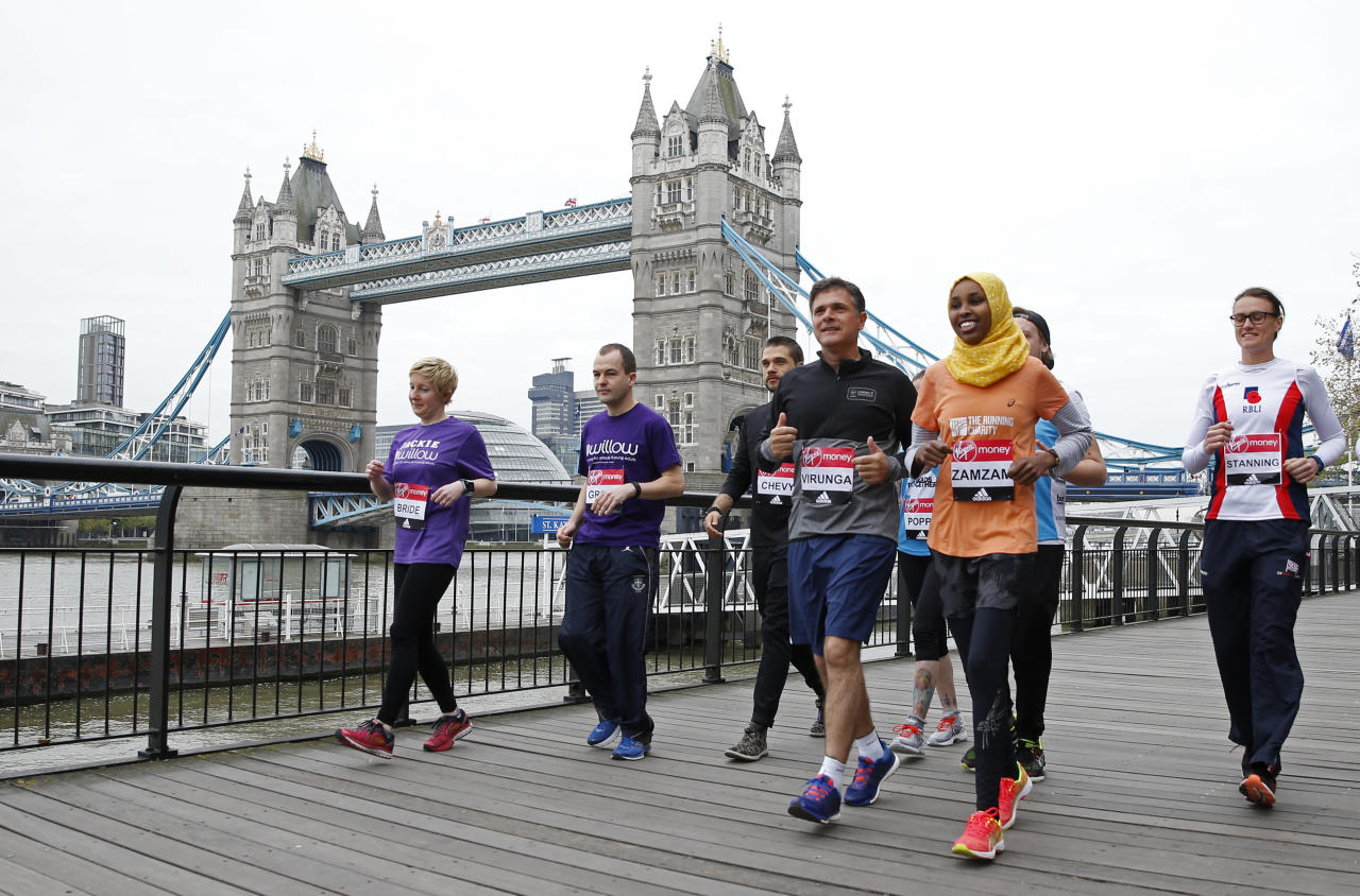 Britain Athletics - London Marathon Previews - London - 21/4/17 (L-R) Bride-to-be Jackie Scully and her fiance Duncan Sloan, Director of Virunga National Park in the Democratic Republic of Congo Emmanuel de Merode, Zamzam Farah who became involved in The Running Charity after seeking asylum in the UK following her appearance for Somalia at the London 2012 Olympic Games and double Olympic gold medallists Heather Stanning ahead of the 2017 Virgin Money London Marathon Action Images via Reuters / Matthew Childs Livepic