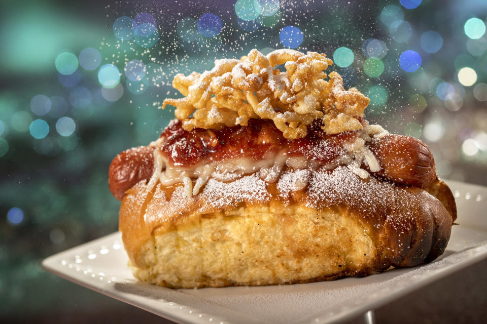 Casey's Corner, located inside Magic Kingdom Park, is serving up this 50th Celebration Hot Dog, topped with funnel cake, powdered sugar and strawberry bacon jam. (Photo: Walt Disney World Resort)