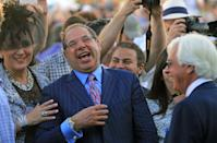 American Pharoah owner and breeder Ahmed Zayat, center, and his wife, Joanne, left, laugh with trainer Bob Baffert, right, in the paddock at Churchill Downs in Louisville, Ky., Saturday, June 13, 2015 before the engraved Kentucky Derby trophy presentation. (AP Photo/Garry Jones)