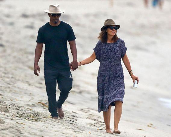 "<p>Perhaps Jamie Foxx and Katie Holmes felt the need to take a page from the Brangelina playbook. After <i>years</i> of dating and never getting photographed, the couple has slowly emerged in the past several months. Still, this was the first PDA photo to give us dating confirmation. These two had nothing to promote or gain after all this time, except for possibly getting the ""money shot"" — aka ""first hand-holding shot"" — off their backs. According to the photographer's caption, the couple splashed around in the ocean before enjoying drinks on their terrace. Super casual. (Photo: BACKGRID) </p>"