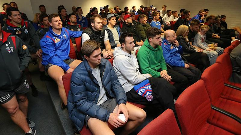 Bulldogs players watch on as Murphy retires. Pic: Getty