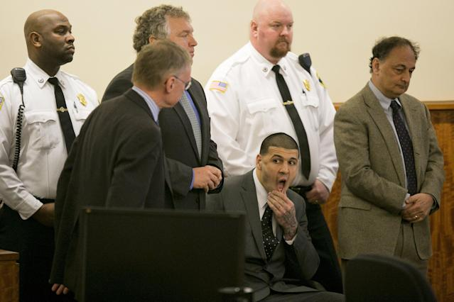 Former NFL player Aaron Hernandez awaits the verdict during his murder trial at the Bristol County Superior Court in Fall River, Massachusetts, April 15, 2015. Hernandez, 25, a former tight end for the New England Patriots, is convicted of fatally shooting semiprofessional football player Odin Lloyd in an industrial park near Hernandez's Massachusetts home in June 2013. REUTERS/Dominick Reuter