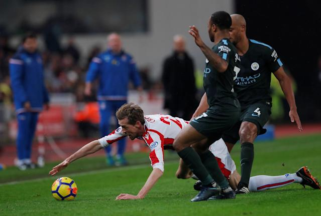 "Soccer Football - Premier League - Stoke City vs Manchester City - bet365 Stadium, Stoke-on-Trent, Britain - March 12, 2018 Stoke City's Peter Crouch in action with Manchester City's Raheem Sterling and Vincent Kompany Action Images via Reuters/Andrew Couldridge EDITORIAL USE ONLY. No use with unauthorized audio, video, data, fixture lists, club/league logos or ""live"" services. Online in-match use limited to 75 images, no video emulation. No use in betting, games or single club/league/player publications. Please contact your account representative for further details."