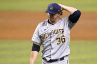 Milwaukee Brewers' Patrick Weigel (36) walks to the dugout during the third inning of a baseball game against the Miami Marlins, Friday, May 7, 2021, in Miami. Floro gave up a grand slam to Marlins' Isan Diaz in the inning. (AP Photo/Lynne Sladky)