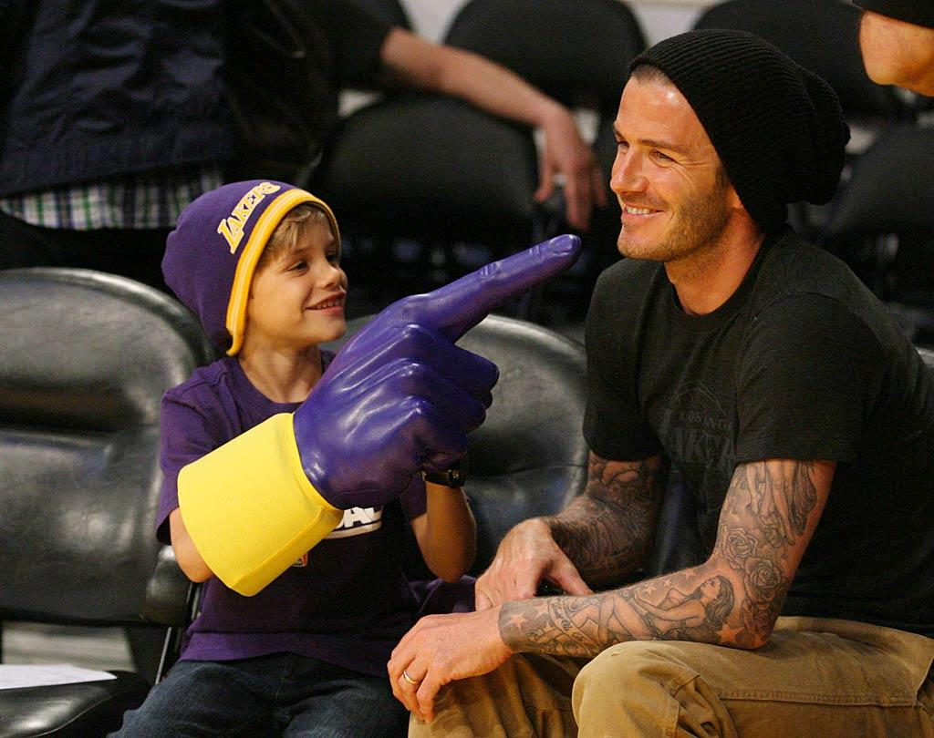 "Having a good time at a Los Angeles Lakers game Thursday were David Beckham and his 8-year-old son Romeo, who saw the home team defeat the Dallas Mavericks 110-82. When making an appearance on ""Jimmy Kimmel Live"" that night, David revealed that Romeo wants to call his baby sister, who is due this summer, ""Justine Bieber Beckham."" London Ent/<a href=""http://www.splashnewsonline.com"" target=""new"">Splash News</a> - March 31, 2011"