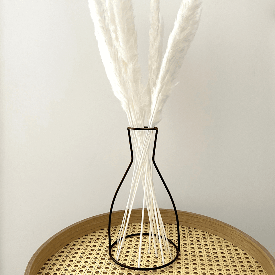 """One more black iron frame, reminiscent of a water jug.<br><br><strong>Contempee</strong> Black Outline Vase no2, $, available at <a href=""""https://www.contempee.com/products/black-outline-vase-no2"""" rel=""""nofollow noopener"""" target=""""_blank"""" data-ylk=""""slk:Contempee"""" class=""""link rapid-noclick-resp"""">Contempee</a>"""