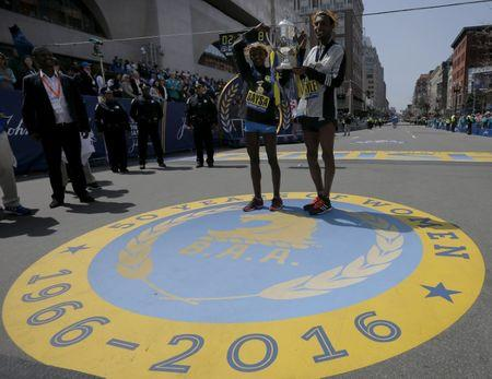Atsede Baysa and Lemi Berhanu Hayle, both of Ethiopia, hold up the trophy after winning the women's and men's division of the 120th running of the Boston Marathon in Boston, Massachusetts April 18, 2016.  REUTERS/Brian Snyder   Picture Supplied by Action Images
