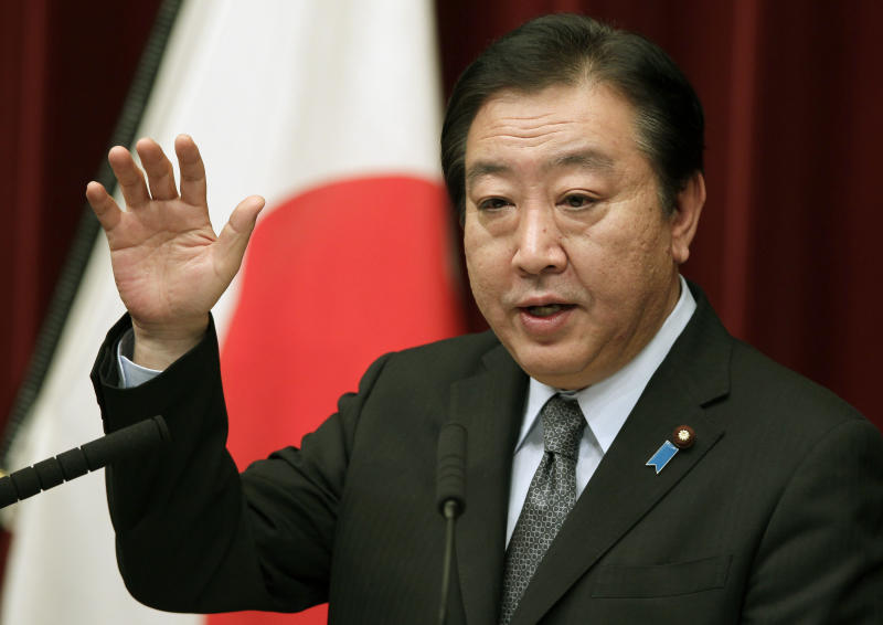 Japan's Prime Minister Yoshihiko Noda speaks during a press conference at his official residence in Tokyo, Friday, March 30, 2012.  Japanese Prime Minister Noda vowed to stake his political career to achieve the sales tax increase Friday as his Cabinet endorsed a legislation to help counter the country's fiscal deficit.  His pledge comes hours after his Cabinet endorsed a bill desgined to raise the 5 percent sales tax in two stages, to 8 percent in 2014 and 10 percent by 2015. (AP Photo/Shizuo Kambayashi)