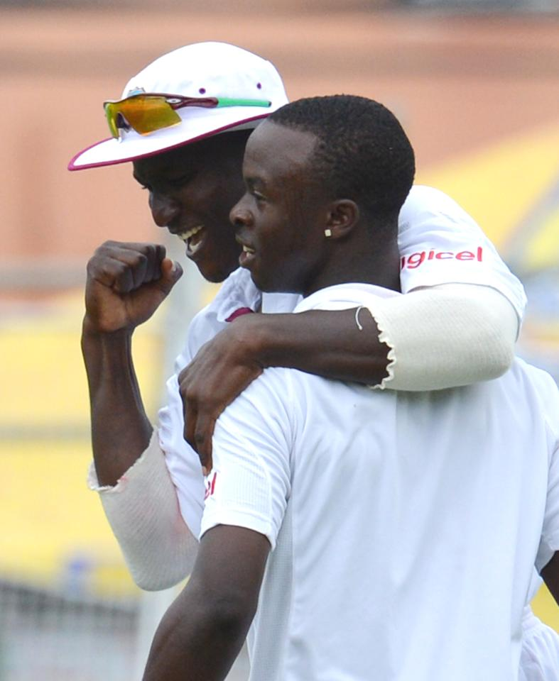 West Indies Kemar Roach (R) celebrates bowling out Australian batsman Ben Hilfenhaus with teammate Darren Sammy (L) during the final day of the second-of-three Test matches between Australia and West Indies April19, 2012 at Queen's Park Oval in Port of Spain, Trinidad.