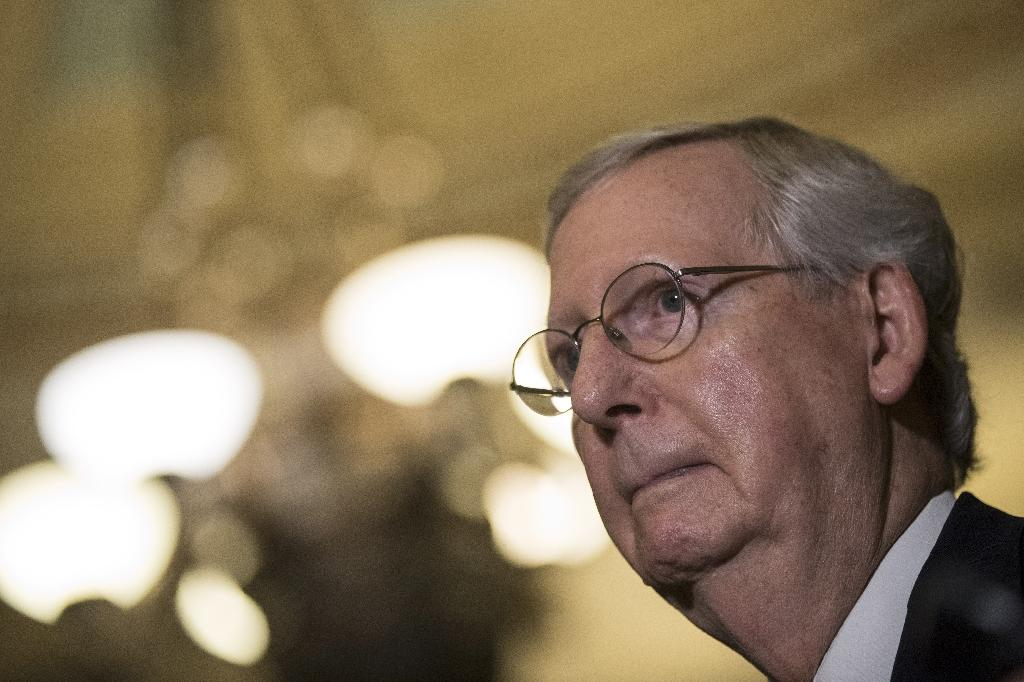 With internal dissent swelling, Senate Majority Leader Mitch McConnell Tuesday postponed a vote on the Republican health care bill intended to replace Obamacare (AFP Photo/Drew Angerer)