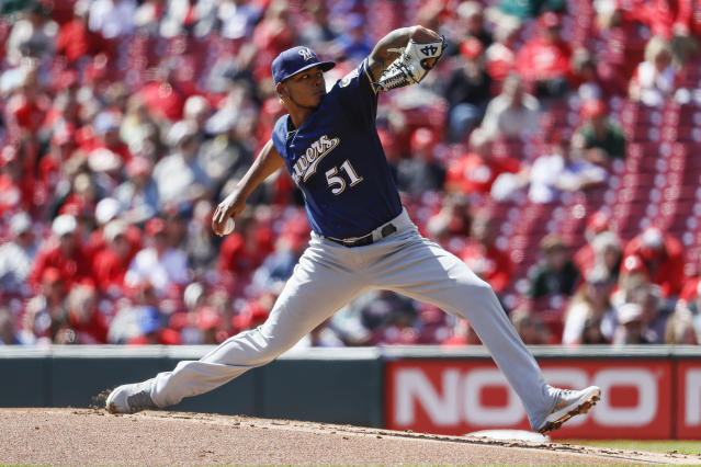 Milwaukee Brewers starting pitcher Freddy Peralta throws in the first inning of a baseball game against the Cincinnati Reds, Wednesday, April 3, 2019, in Cincinnati. (AP Photo/John Minchillo)